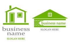Logo avec la maison. Photos libres de droits