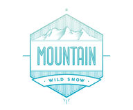 Logo badge for creative design project. Label related to mountain theme - blue mountain on a white background. Stock Photos