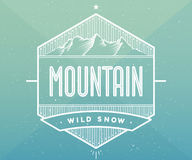 Logo badge for creative design project. Label related to mountain theme. Vector illustration. Royalty Free Stock Photography