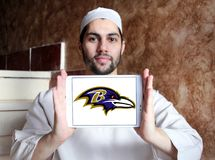 Baltimore Ravens american football team logo. Logo of Baltimore Ravens american football team on samsung tablet holded by arab muslim man. The Baltimore Ravens Stock Photography