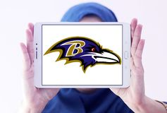 Baltimore Ravens american football team logo. Logo of Baltimore Ravens american football team on samsung tablet holded by arab muslim woman. The Baltimore Ravens Stock Images