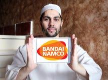Bandai Namco Entertainment logo. Logo of Bandai Namco Entertainment company on samsúng tablet holded by arab muslim man. Bandai Namco Entertainment Inc. BNEI is Stock Images