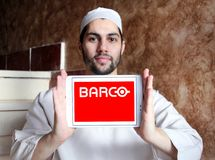 Barco manufacturer logo. Logo of Barco manufacturer on samsung tablet holded nby arab muslim man. Barco NV is a technology company that develops sight, sound Stock Photo