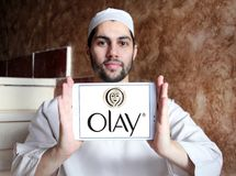 Olay logo. Logo of beauty and cosmetics company olay on samsung tablet holded by arab muslim man royalty free stock images