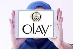 Olay logo. Logo of beauty and cosmetics company olay on samsung tablet holded by arab muslim woman royalty free stock photo