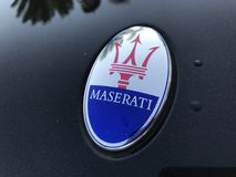 Logo of beauty Maserati car. Marbella, Spain - August 10, 2018: Logo of a Maserati car parked inside the famous Puerto Banus. Luxury port where you can take a stock photography