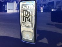 Logo of Beauty Rolls Royce car. Marbella, Spain - August 10, 2018: Logo of a Rolls Royce car parked inside the famous Puerto Banus. Luxury port where you can royalty free stock photos