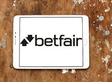 Betfair gambling company logo. Logo of Betfair gambling company on samsung tablet on wooden background. Betfair is an online gambling company which operates the Stock Images