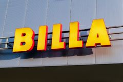 Logo of Billa grocery chain on the grey wall of a shopping mal royalty free stock photo