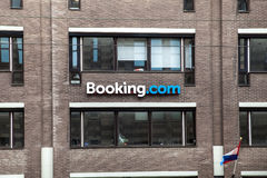 Logo of Booking.com brand on the wall in Amsterdam city, Netherlands Stock Photography
