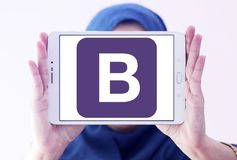 Bootstrap website logo. Logo of Bootstrap website on samsung tablet holded by arab muslim woman. Bootstrap is a free and open source front end library for royalty free stock images