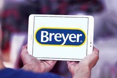 Breyer manufacturer logo. Logo of Breyer manufacturer on samsung tablet. Breyer  is a manufacturer of model animals. The company specializes in model horses made Stock Images