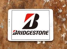 Bridgestone tyre manufacturer logo. Logo of bridgestone tyre manufacturer on samsung  tablet on wooden background. Bridgestone Corporation is a multinational Royalty Free Stock Photo