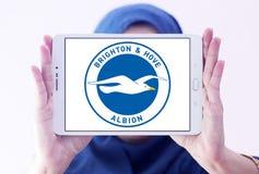 Brighton & Hove Albion F.C. football club logo. Logo of Brighton & Hove Albion F.C. soccer club on samsung tablet holded by arab muslim woman Stock Photos