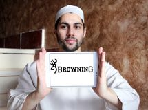 Browning Arms Company logo. Logo of Browning Arms Company on samsung tablet holded by arab muslim man. Browning is an American maker of firearms and fishing gear stock photo