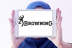 Browning Arms Company logo. Logo of Browning Arms Company on samsung tablet holded by arab muslim woman. Browning is an American maker of firearms and fishing stock photo