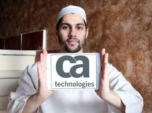 CA Technologies logo. Logo of CA Technologies on samsung tablet holded by arab muslim man. CA Technologies is an American multinational publicly held corporation Stock Image