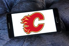 Calgary Flames ice hockey team logo. Logo of Calgary Flames ice hockey team on samsung mobile. The Calgary Flames are a professional ice hockey team based in Stock Photography