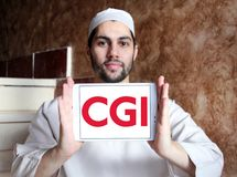 CGI Group logo. Logo of CGI Group on samsung tablet holded by arab muslim man. CGI is a Canadian global information technology IT consulting, systems integration royalty free stock photo