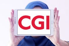 CGI Group logo. Logo of CGI Group on samsung tablet holded by arab muslim woman. CGI is a Canadian global information technology IT consulting, systems royalty free stock photos