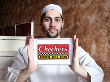 Checkers fast food restaurant logo. Logo of checkers fast food restaurant on samsung tablet holded by arab muslim man Stock Image