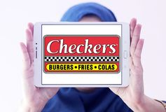 Checkers fast food restaurant logo. Logo of checkers fast food restaurant on samsung tablet holded by arab muslim woman Stock Images