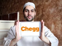 Chegg education technology company logo. Logo of Chegg company on samsung tablet holded by arab muslim man. Chegg, Inc. is an American education technology stock photos