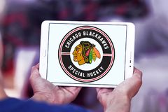 Chicago Blackhawks hockey team logo. Logo of Chicago Blackhawks hockey team on samsung tablet. Chicago Blackhawks are a professional ice hockey team in NHL based stock photo