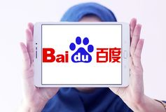 Baidu logo. Logo of the Chinese-American web services company Baidu on samsung tablet holded by arab muslim woman stock image