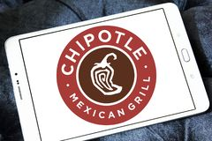 Chipotle Mexican Grill fast food logo. Logo of Chipotle Mexican Grill fast food on samsung tablet. Chipotle is an American chain of fast casual restaurants stock photography