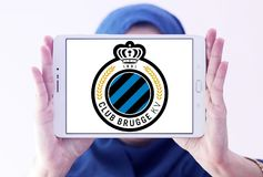 Club Brugge football club logo. Logo of Club Brugge football club on samsung tablet holded by arab muslim woman. Club Brugge, is a football club based in Bruges Stock Images