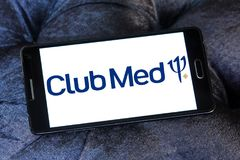 Club Med tourism company logo. Logo of Club Med tourism company on samsung mobile. Club Med is a private French company specializing in premium all inclusive stock photo