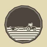 Logo con un'aratura del trattore Fotografie Stock