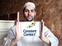 Constant Contact marketing company logo. Logo of Constant Contact on samsung tablet holded by arab muslim man. Constant Contact, Inc. is an online marketing Stock Photography