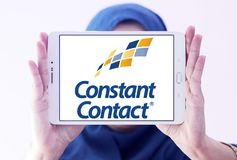 Constant Contact marketing company logo. Logo of Constant Contact on samsung tablet holded by arab muslim woman. Constant Contact, Inc. is an online marketing Royalty Free Stock Image