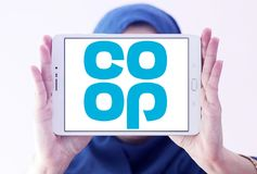 Coop company logo. Logo of coop company on samsung tablet holded by arab muslim woman. they offer wider range of products and services including car insurance Royalty Free Stock Image
