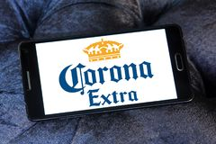 Corona extra beer logo. Logo of Corona extra beer on samsung mobile. Corona Extra is a pale lager produced by Cervecería Modelo in Mexico for domestic stock photography