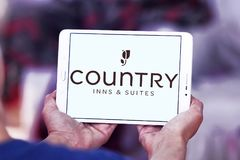 Country Inns and Suites logo. Logo of Country Inns and Suites on samsung tablet. Country Inns and Suites by Radisson is an American hotel brand owned by the royalty free stock image