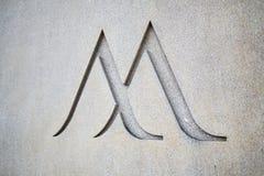 Logo d'hôtel de Marriott découpé dans la pierre photographie stock