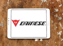 Dainese brand logo. Logo of Dainese company on samsung tablet. Dainese is an Italian manufacturer of protective gear and clothing for sports, including royalty free stock image