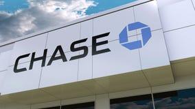 Logo de JPMorgan Chase Bank sur la façade moderne de bâtiment Rendu 3D éditorial Images stock