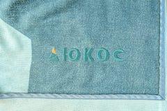 Logo de la compagnie Ioukos sur une couverture photo libre de droits
