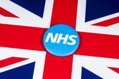 Logo de NHS sur le drapeau BRITANNIQUE Image libre de droits