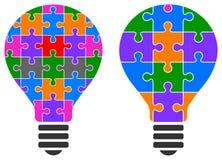Logo de puzzle d'ampoule Photos libres de droits