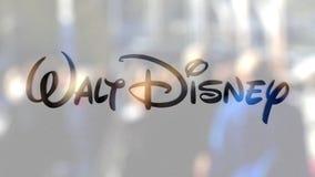 Logo de Walt Disney Pictures sur un verre contre la foule brouillée sur le steet Rendu 3D éditorial Photo libre de droits