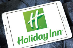 Logo degli hotel della locanda di Hotliday Immagine Stock