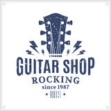 Logo del negozio della chitarra illustrazione di stock