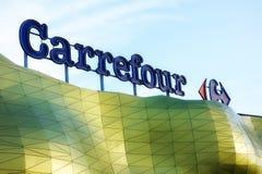 Logo del supermercato del Carrefour Immagini Stock