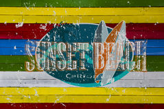 Logo della spiaggia di tramonto immagine stock