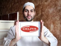 Delphi Technologies logo. Logo of Delphi Technologies on samsung tablet holded by arab muslim man. The company provides combustion systems, electrification Royalty Free Stock Photography